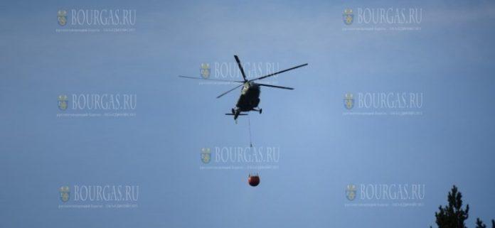 вертолет Cougar тушит пожар